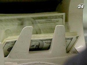 Юань не сможет составить конкуренцию доллару