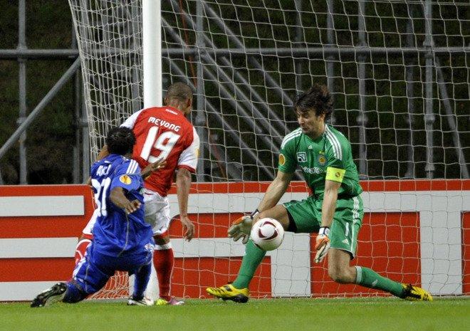 FC Dynamo Kiev's Goalkeeper Olexandr Shovkovskly (R) Saves A Shot From SC Braga's Forward From Cameroon's Albert Meyong