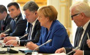 Ангела Меркель и Пётр Порошенко. Фото пресс-службы Президента России